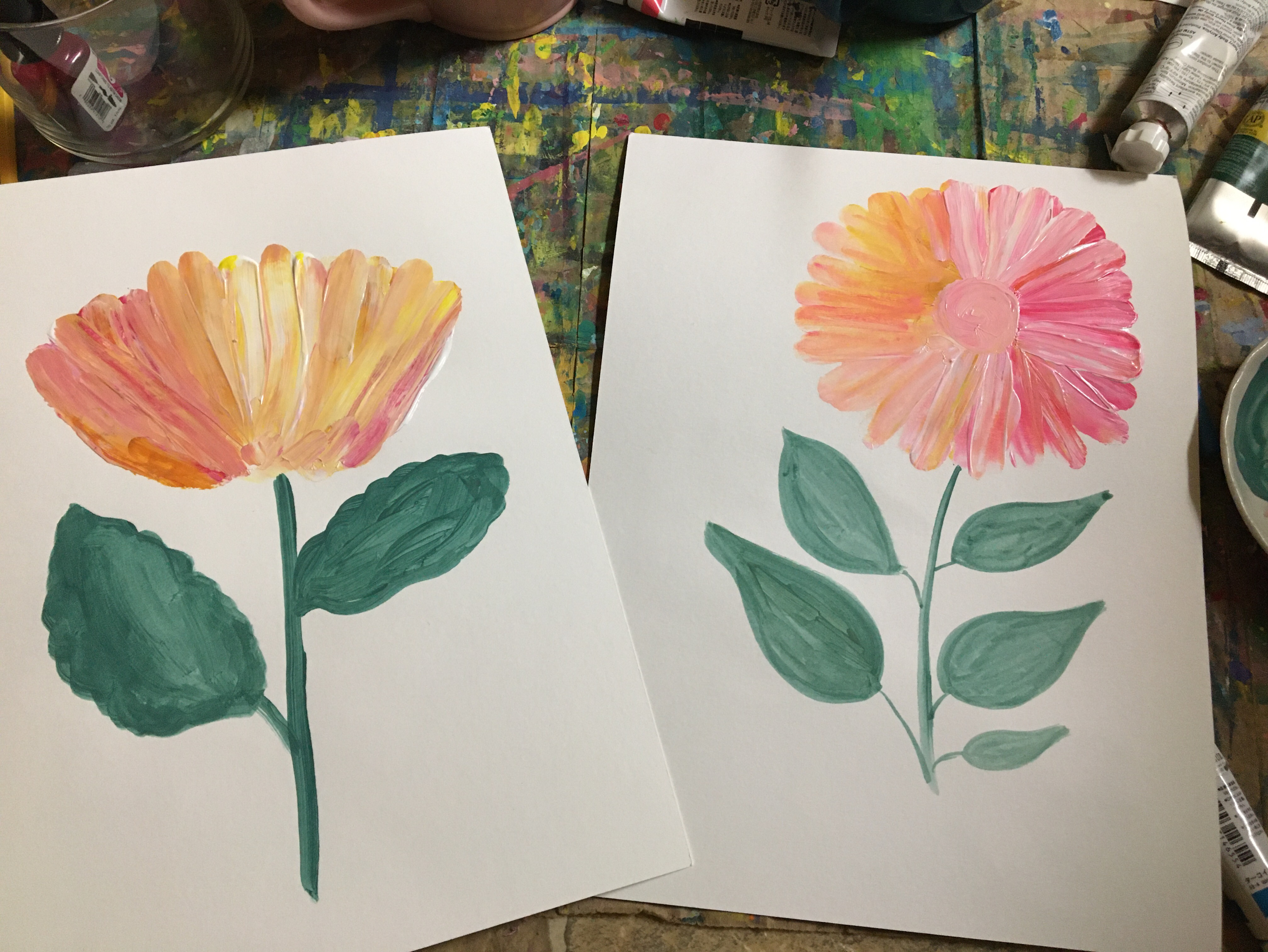 mix up pinks and oranges and paint a flower with your finger.
