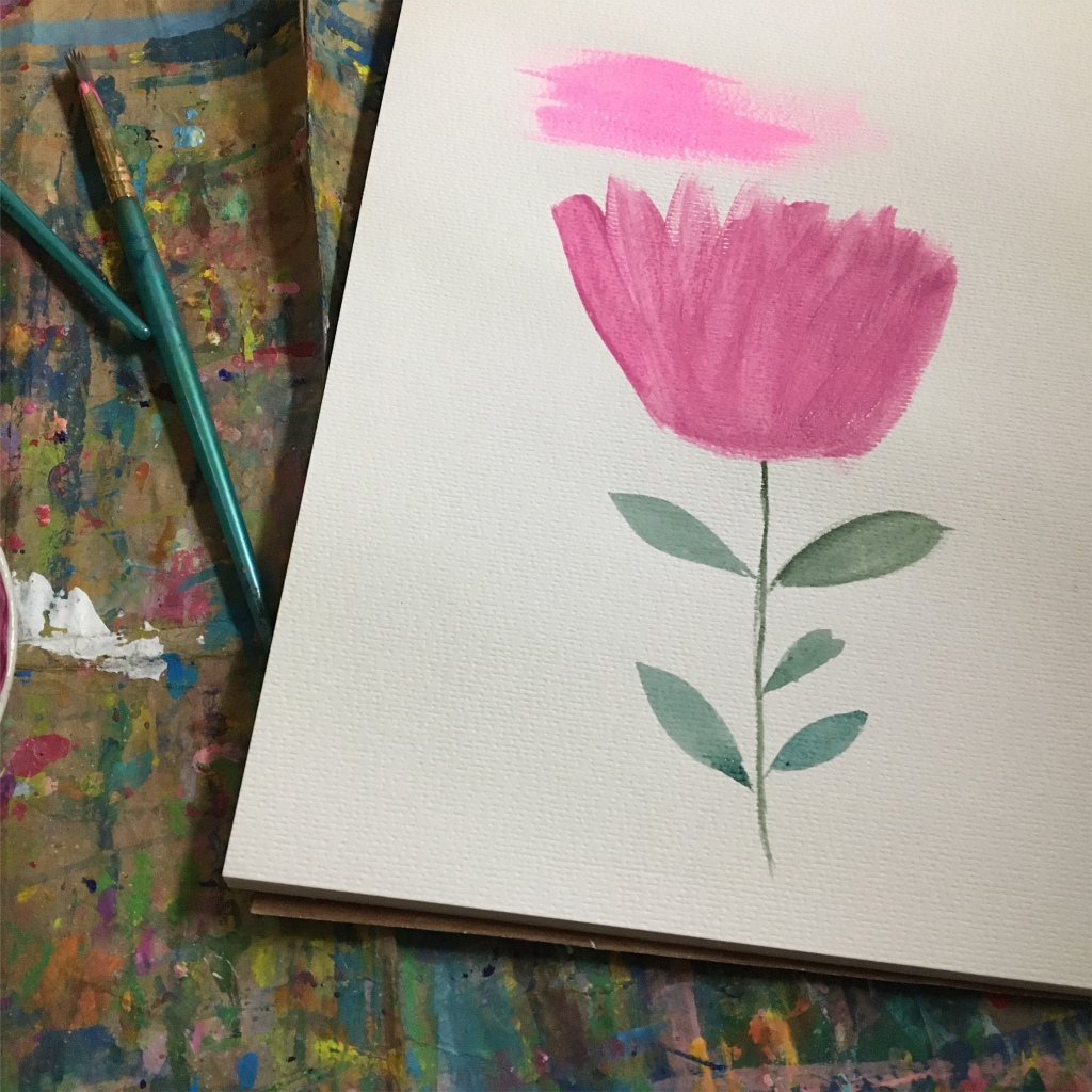 Use a flat brush to paint pink flowers
