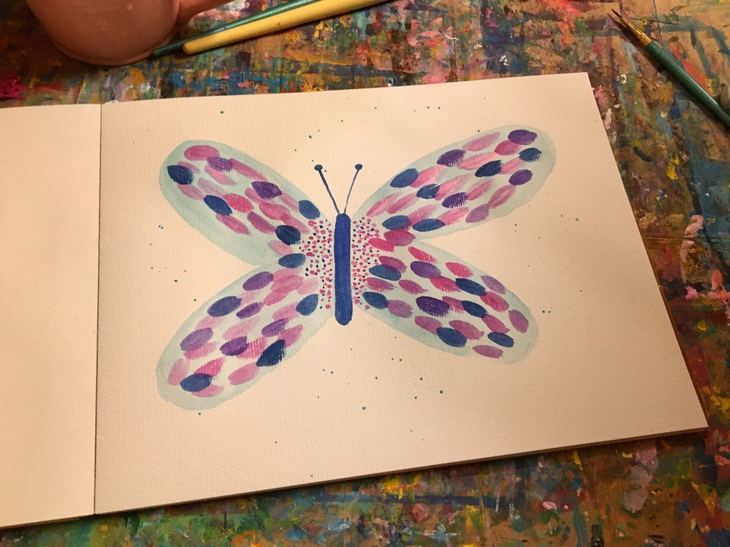 Paint a blue and pink brush stroke butterfly to boost your creativity